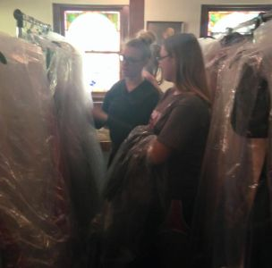 Tobie Roberts and her mother Michelle looking through their inventory of dresses