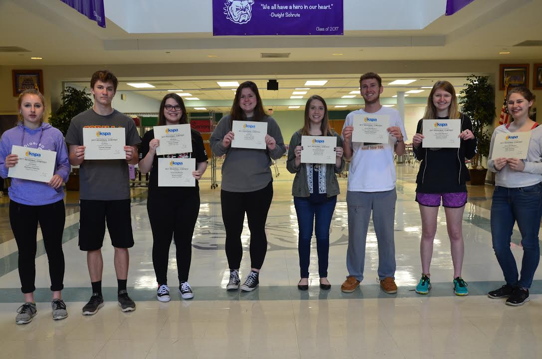 Journalism students received award certificates for their work at KSPA Regionals. From left to right: Rachael Fritzsche, Garrett Owings, Grace Cooper, Emily Bennett, Quinna Lund, Hayden Burkhart, Jessi Dowell, Ellie Thurlow.