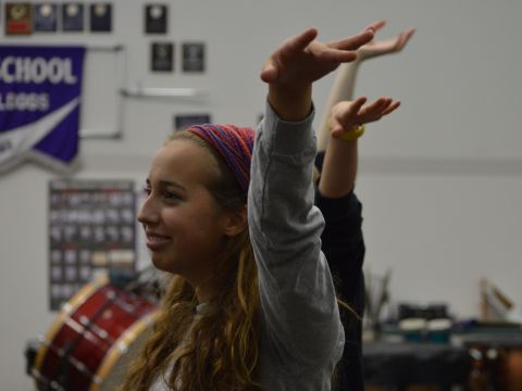 Sophomore Kayla Mountain rehearsing for Seussical
