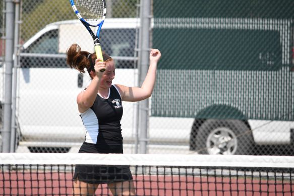 Sophomore Makena Martinez celebrating a point win at the at the Baldwin Invitational Tournament.