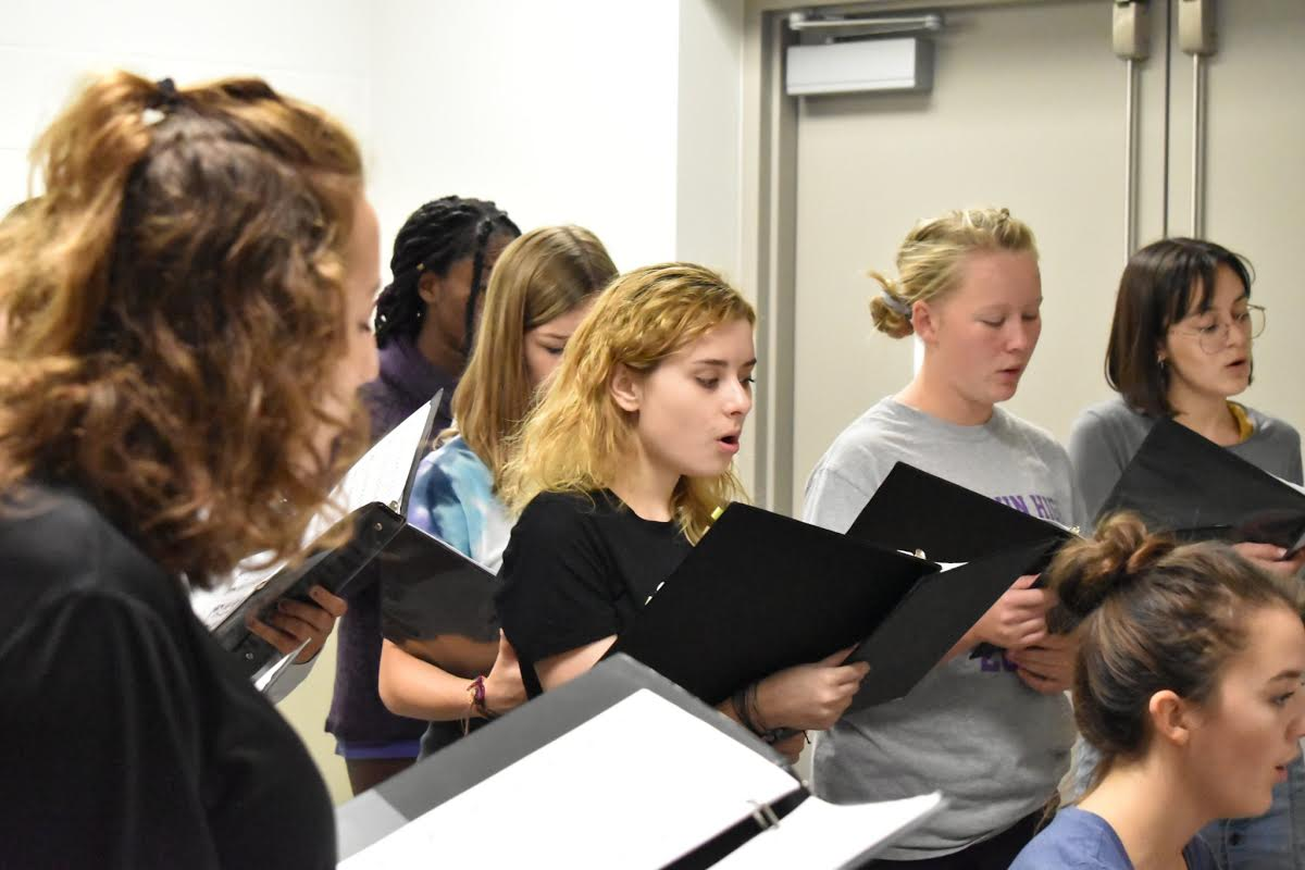The concert choir working hard to prepare for the fall concert.