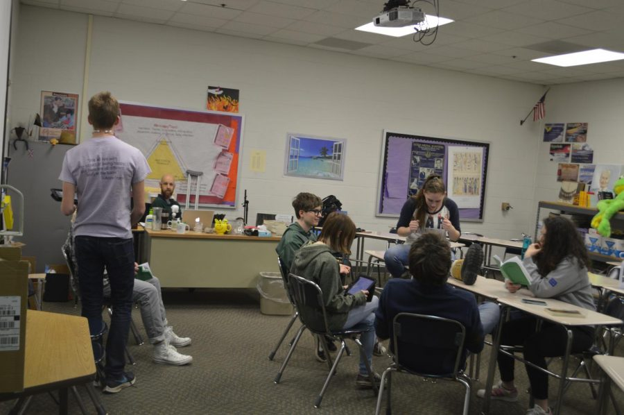 The cast members for the spring play pictured working together on parts. The members began working with Mr. Stephens about a month ago.