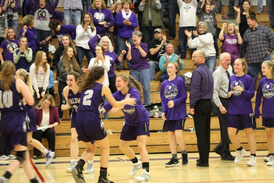 The Baldwin girls basketball team is celebrating their victory. They beat Nehama 47-46 to win the Top Gun Tournament.
