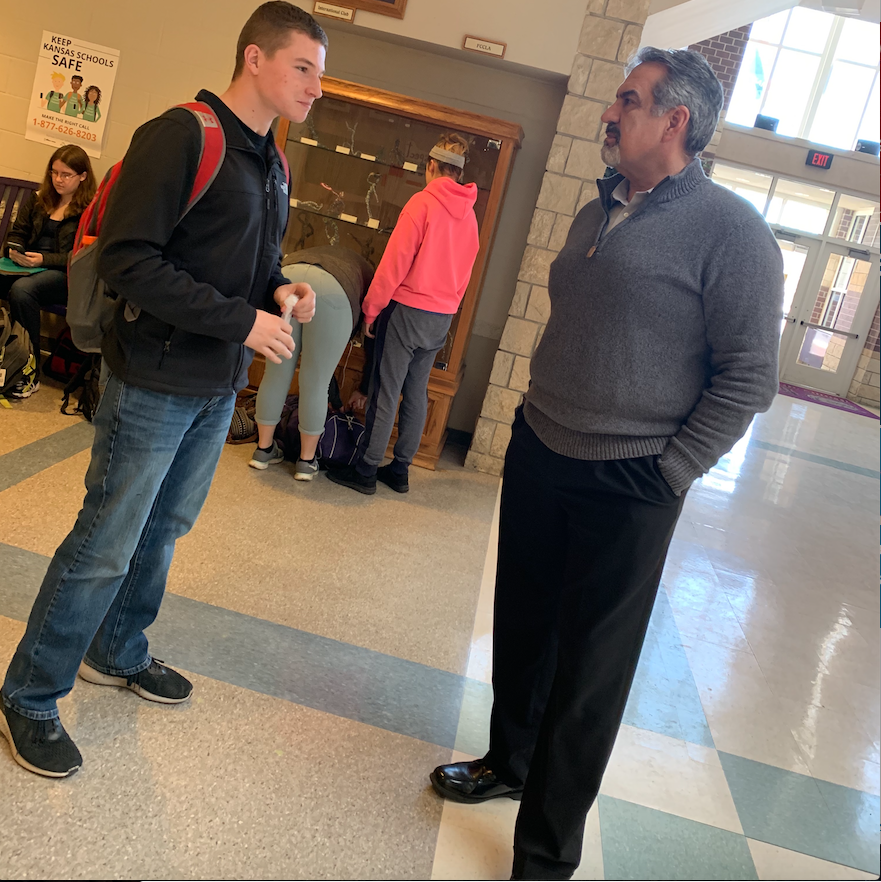 Frank Perbeck talking to sophomore student Shane Doty. Perbeck has been very busy since he has taken over as head principal.