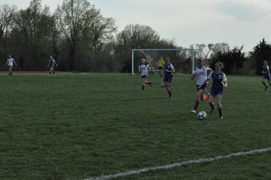 Riley Smith runs the ball up the field. They played Cair Paravel.
