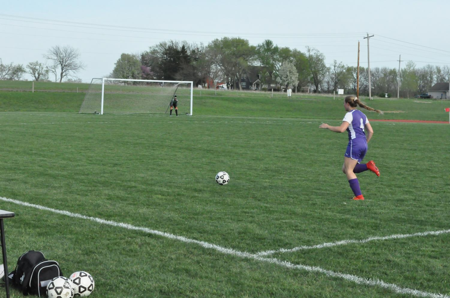 Cambria Crowe is taking the ball down to score.