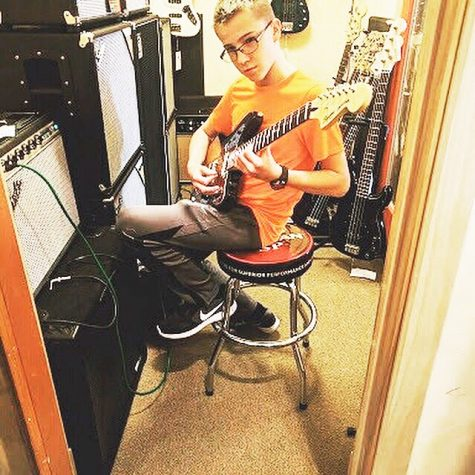 Freshman Lucas Hafer progresses from playing guitars to building them
