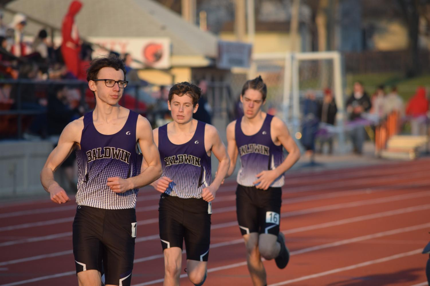 Jude Stacey, Collin Ediger, and Crayton Walters run the mile at the BIT track meet.